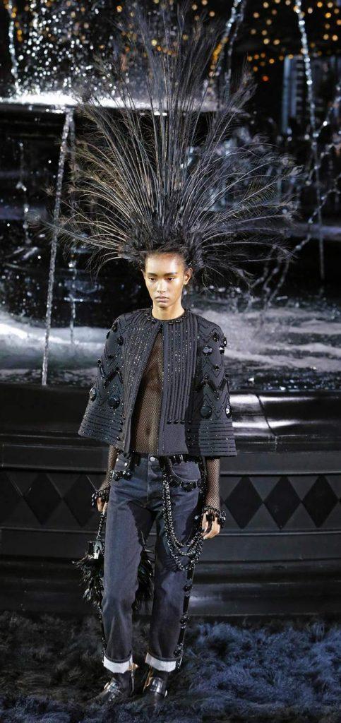 Jeans, top e giacca Louis Vuitton