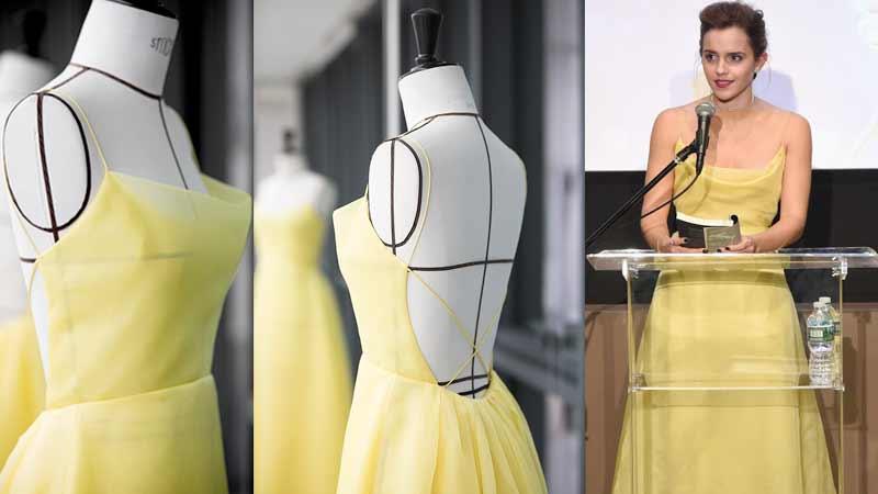 Emma Watson, abito Dior caratterizzato da collo a cappuccio tagliato di sbieco mentre, sul retro, il volume è maggiore