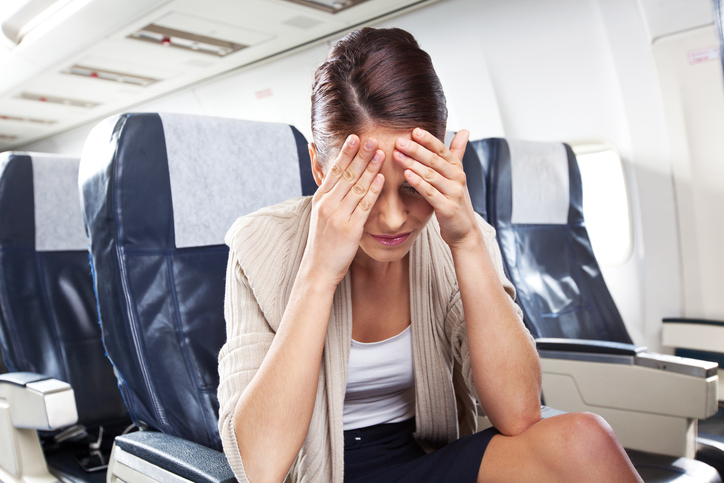 Effetti collaterali di un volo: mal di testa